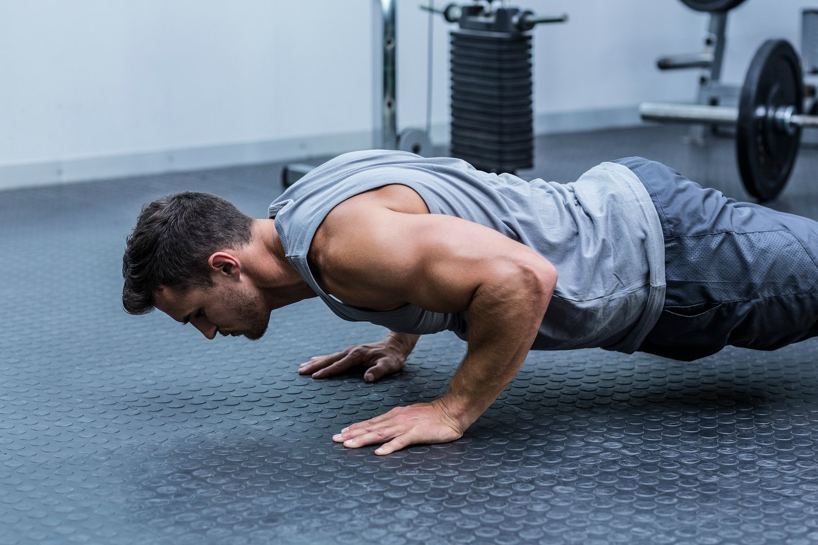 Perform the plank and push-ups to get your CrossFit workout at home!