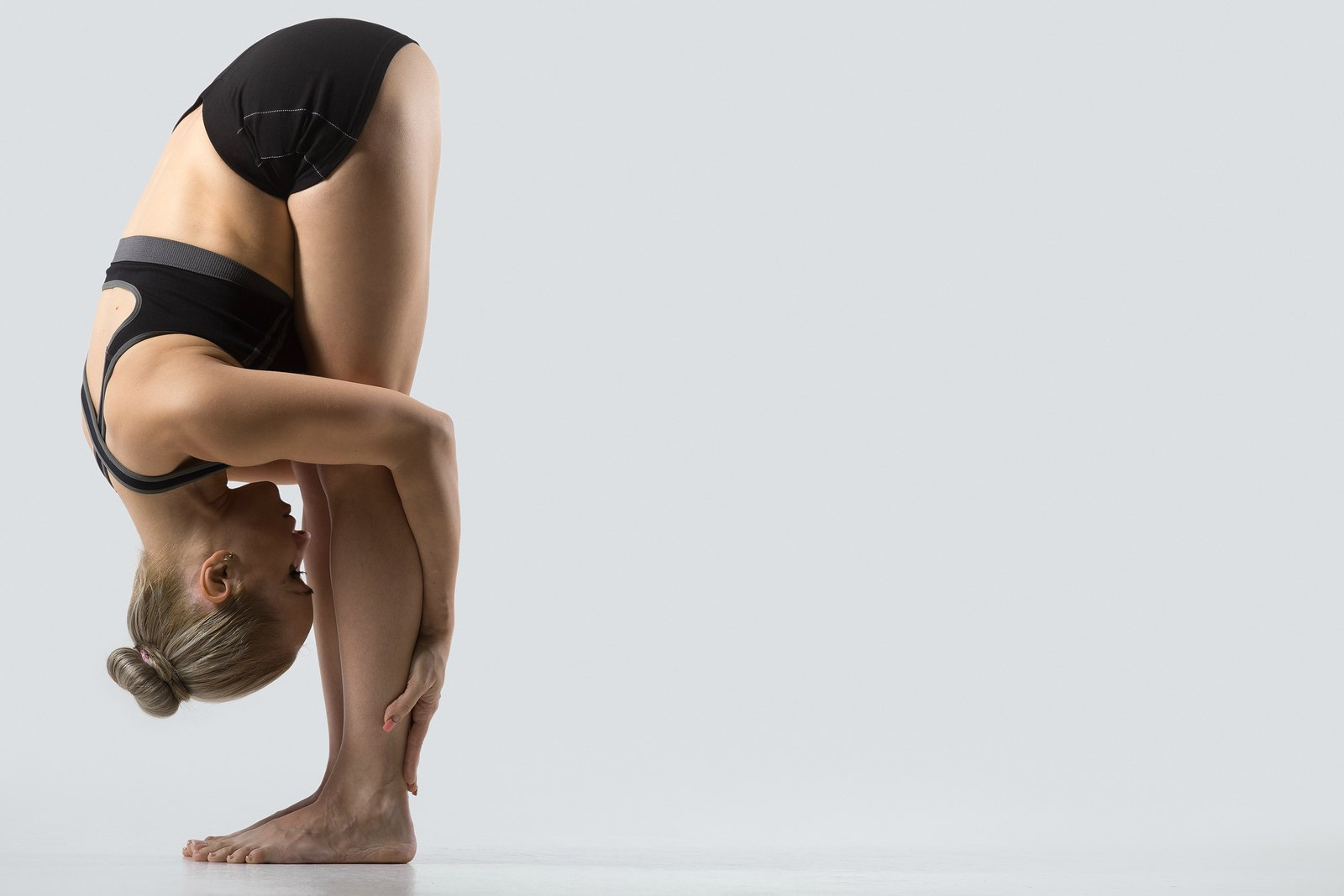Practising Yoga regularly can help reduce back pain
